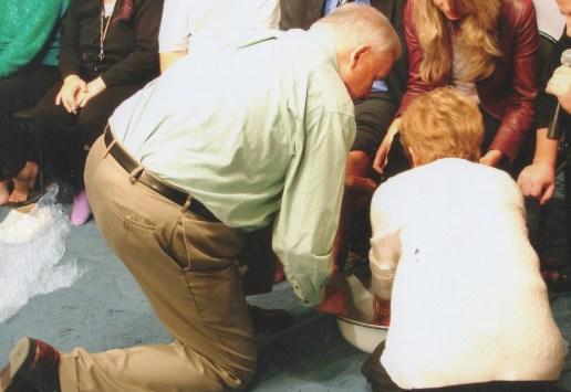 Pastor Ron Foot washing cropped