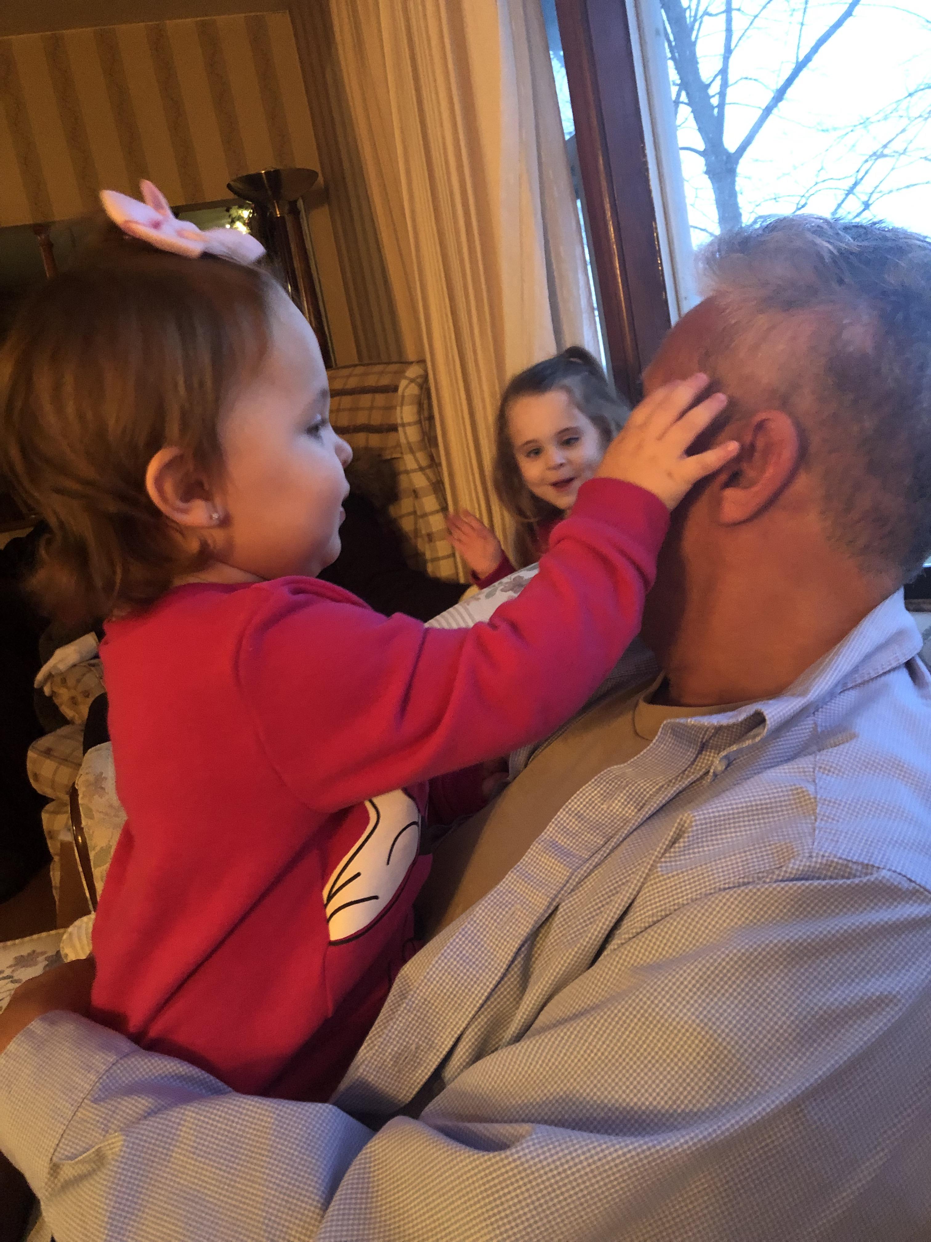 Aubrey touching papa's face