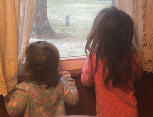 girls looking out window