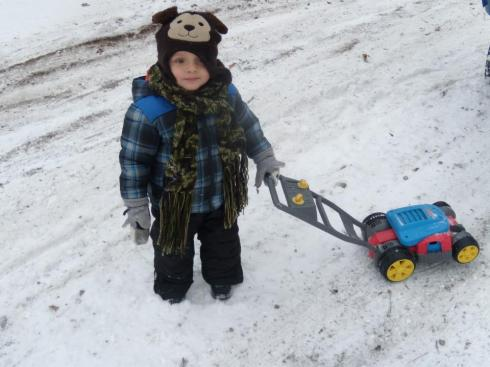 2013 ethan with lawn mower in snow