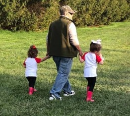 father grandfather david walking with girls at baseball