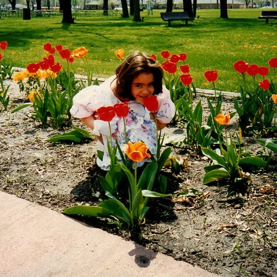 USE audra smelling flowers