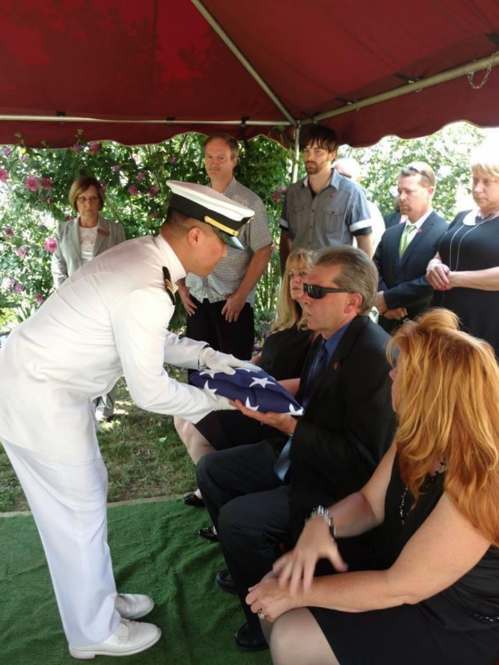 mark receiving flag at dads funeral