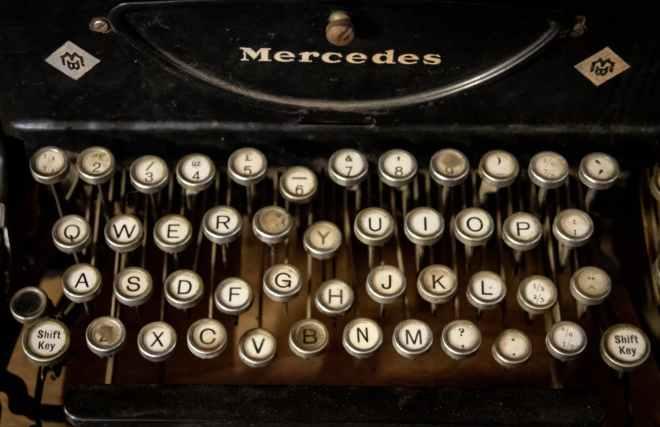 black and white typewriter on black table