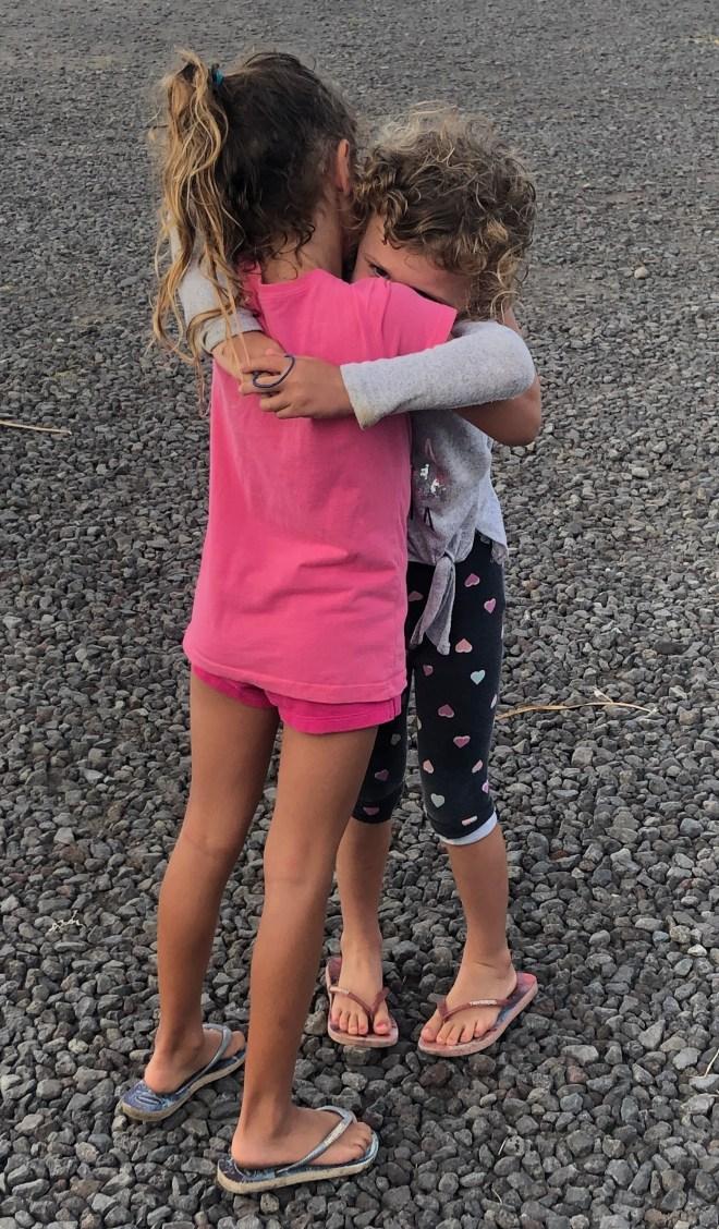 Rosalee Kizzie hugging
