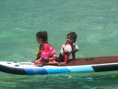 Rosalee Kizzie on surfboard