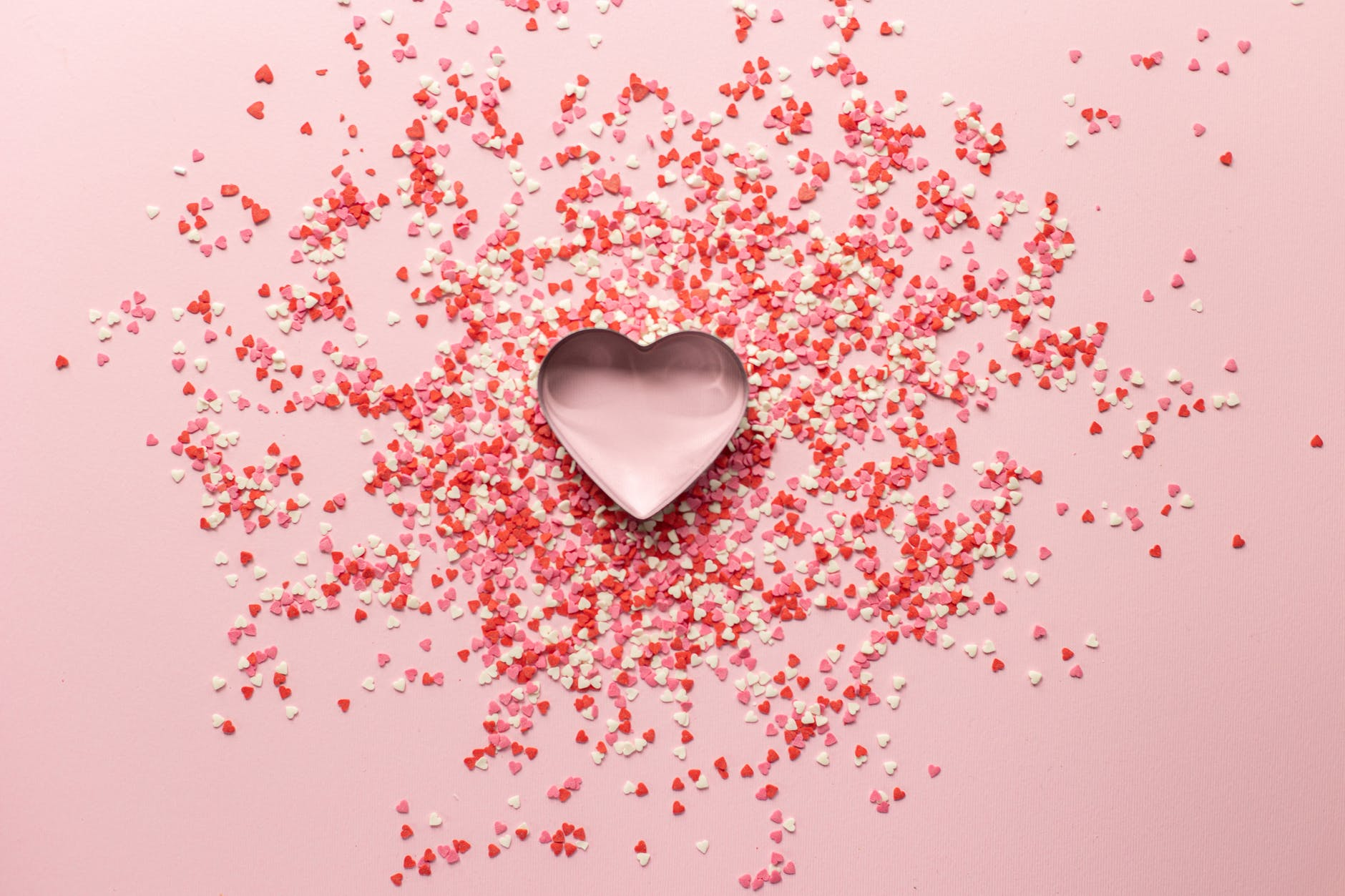 heart shaped baking tin with small confetti on surface for valentine day