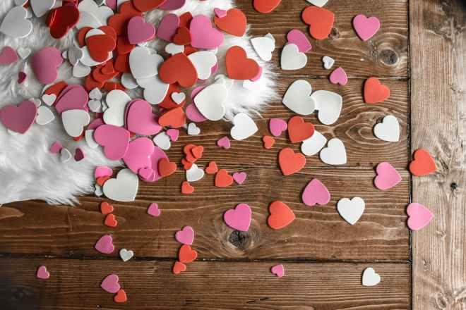 heart shaped confetti on wooden floor